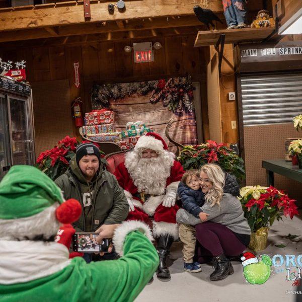 family wiht santa and camera